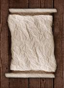 Worn Parchment Paper On a Wooden Rustic Background Stock Photos