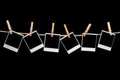 Polaroids Hanging on Black Background - stock photo
