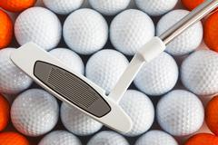 Golf putter and balls - stock photo