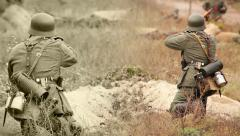 Nazi soldiers shooting with a rifle and mortar in trench . WWII old film movie Stock Footage