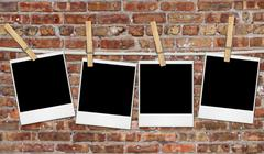 Empty Film Blanks Hanging Against a Grungy Brick Wall Stock Photos