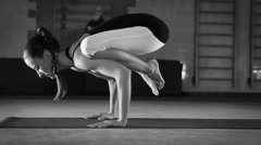 Young flexible Female doing yoga Crane pose Stock Footage