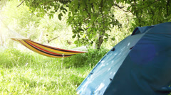 Camping equipment: touristic Tent and Hammock between the trees Stock Footage
