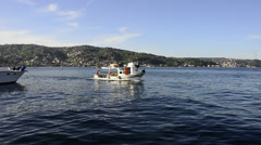 Fisherman boat is moving on a sunny day at Istanbul Stock Footage
