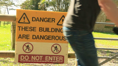 Danger these buildings are dangerous do not enter sign 02 Stock Footage