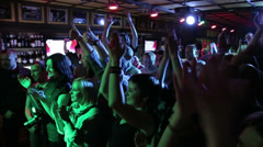 People applauding at a rock concert 1 - stock footage