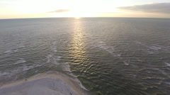 180 degree pan of the beach at sunset, aerial 2.7K view Stock Footage