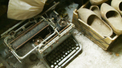 Vintage typewriter next to box clogs Stock Footage