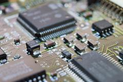 Electronic circuit chip on board Stock Photos