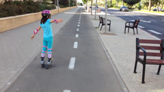 Girl on roller blades Stock Footage