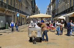 rua augusta in lisbon, portugal - stock photo