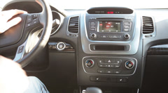 Driver starting and stopping engine of car with button on dashboard Stock Footage