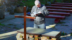 Religious man with Holy Bible at place of worship episode 5 Stock Footage