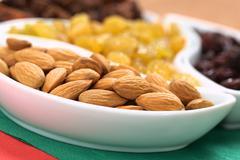Almonds and raisins Stock Photos