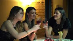 Elegant girlfriends raising toast by the table at night party, slow motion HD Stock Footage