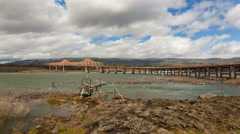 The Dalles Dam and Dalles Bridge Across Columbia River Gorge Moving White Clouds - stock footage