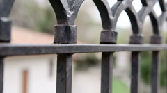 Dolly: Wrought iron fencing - stock footage