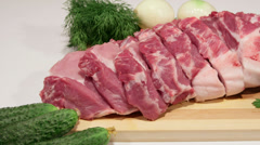 Dolly: Sliced fresh pork meat and vegetables Stock Footage