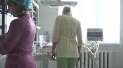 Nurses go, leaving premature baby lying in incubator Stock Footage