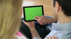 Couple looking at pictures on electronic tablet Stock Footage