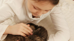 Girl stroking two cute kittens Stock Footage