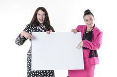 2 XXL models with an empty plate Stock Photos