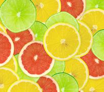 Abstract background of citrus slices. Closeup. Studio photograph - stock illustration