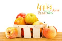 Fresh and colorful apples in basket - stock illustration