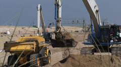 Loading sand. Construction of a soft seawall (artificial dune landscape) Stock Footage