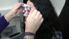 Lens fitting by an eye doctor Stock Footage