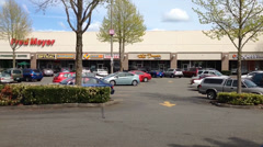 Fred Meyer Store Anchors Independent Businesses In A Mini-Mall Stock Footage