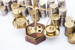 A lot of money! Coins on scales Stock Photos