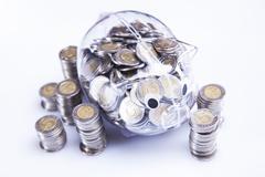Savings in piggy bank! A lot of money! Stock Photos