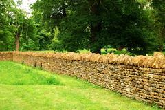 Countryside garden, stone wall Stock Photos