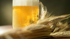 Pint of beer with barley,panning, studio shooting, bubbles rising up Stock Footage