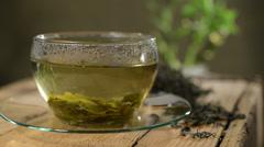 Loose tea and cup of tea, rotation of tea Stock Footage