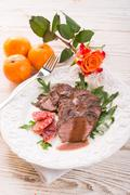 Crunchy duck's breast with orange and rucola Stock Photos