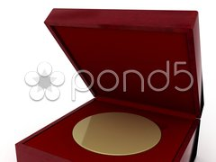 Stock Photo of Golden medal in red gift box