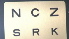 Eye test by the eye doctor in hospital Stock Footage