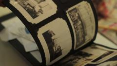 Going through old photographs from 1930s and 1940s - 5 clips Stock Footage
