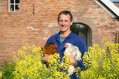 farmer with chickens - stock photo