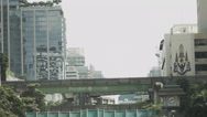 Stock Video Footage of Pan From Buildings To Street Scene With Cars And Mopeds In Bangkok - Thailand