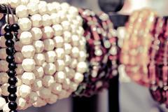 bead bangles in shop of surajkund fair, retro style - stock photo
