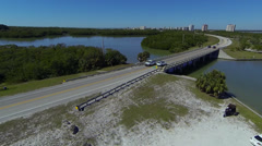 Rising up over a coastal highway Stock Footage