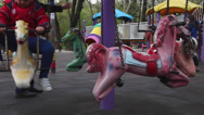 Stock Video Footage of Happy boy riding a horse carousel, Merry go round, playground, children, park