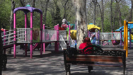 Stock Video Footage of Happy kids running on children's playground, beautiful spring day