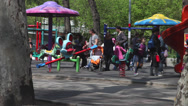 Stock Video Footage of Children's playground, kids, parents, carousel, seesaw, slide, park, spring