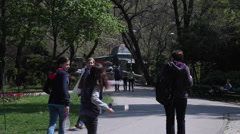 Beautiful day spring in the park, people walking, riding bicycle Stock Footage