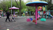 Stock Video Footage of Playground, children, grandfather walking, carousel, soap bubbles