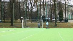 Young boy playing soccer with friend Stock Footage